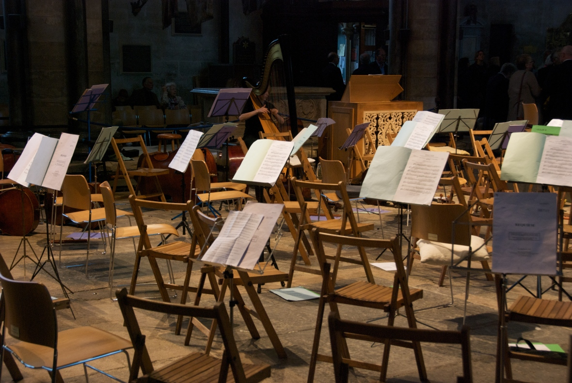empty orchestra chairs with music on stands