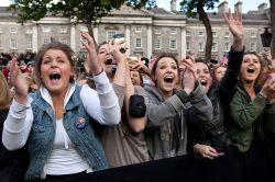women screaming in excitement