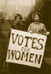 Suffragettes with Votes for women sign